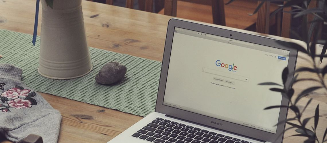 Laptop on Table showing Google